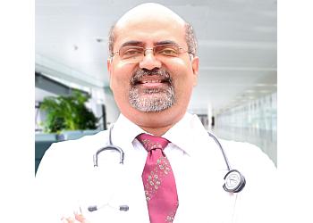 DR. JOHNY J. KANNAMPILLY, MBBS, MD