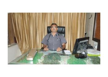 DR. M. A. KARMUR, MBBS, MD