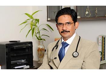 DR. MANOJ SHARAD CHITALE, MBBS, MD