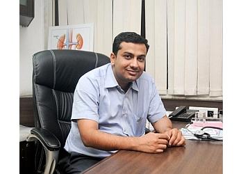 DR. PRAGNESH BHAPODA MBBS, MS, MCh