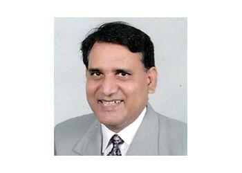 Dr. Amilal Bhat, MS, M.CH, FICG, FICS