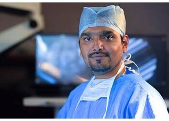 Dr. Amit Bindal, MBBS, MCh, MS - BINDAL CLINICS