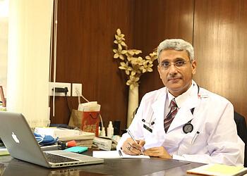 Dr. Anil Dhall, MBBS, MD, DM, FACC, FESC, FSCAI, FHRS, FCSI