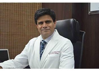 Dr. Ashish Davalbhakta, MB, MS, MCH, FRCS