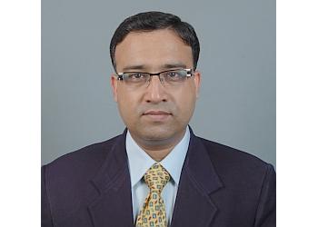 Dr. Atul Kasliwal, MBBS, MD, DM, FNB, FESC