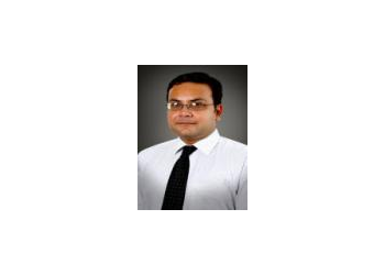 Dr. Basab Mukherjee, MBBS, MD, MRCOG,  FRCOG, FICOG