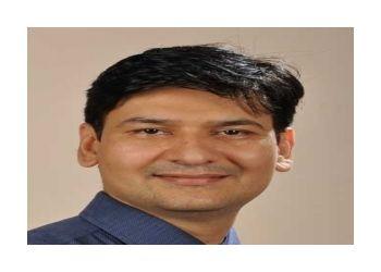 Dr. Dilip Mishra, MBBS, MS, M.Ch, FRLS