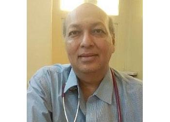 Dr. Dinesh K. Garg, MBBS, MD