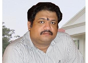 Dr. E. Balagurusamy, MD, DPM