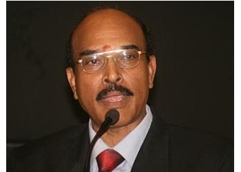 Dr. M. Kumaresan,  MS, DLO, FICS, FIMSA