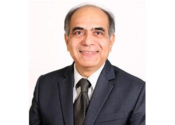 Dr. Madan Kapre, mbbs, FRCS, DLO