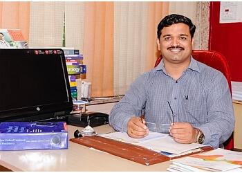 Dr. Nikhil M. Pande, MBBS, MD, DPM