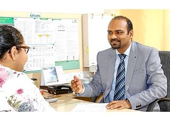 Dr. Pawan Ojha, MBBS, DM, DNB, FCPS - BRAIN CENTRE