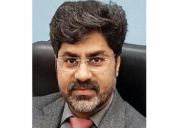 Dr. R. K. Mishra, MS, DNB, MCh, DNB, MNAMS, FICS