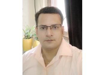 Dr. R K Pandey, MBBS, MD, DM