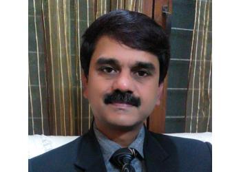 Dr R K Singh, MBBS, MS
