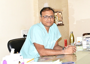 Dr. Ravindra Bansal, MBBS, MS