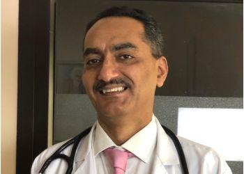 Dr. Sandeep Singh Sidhu, MBBS, MD, DM