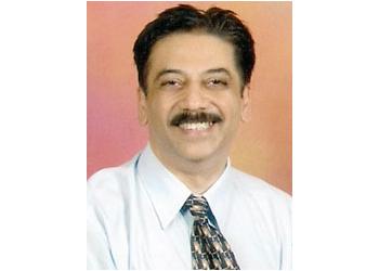 Dr. Suresh M Dugani, MBBS, MCh, FIAMS