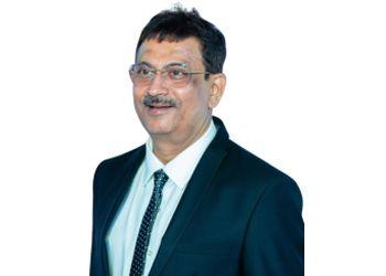 Dr. Suresh Zinzuvadia, MBBS, MD, DM - GASTRO CARE HOSPITAL