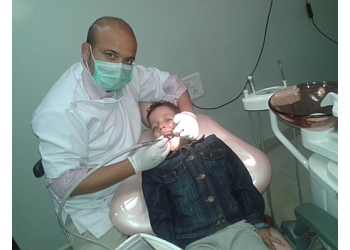 Dr. TANMAY SHARMA, BDS, MDS