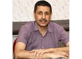 Dr. T Ravishankar, MBBS, MD, DM