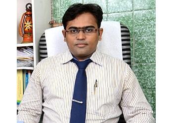 Dr. Vijay Chinchole, MBBS, MD, DPM