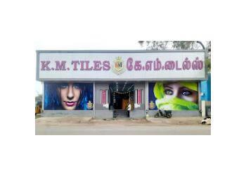 K.M. TILES